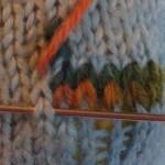 Op de kop de tweede toer: rechterhelft van de steek.
